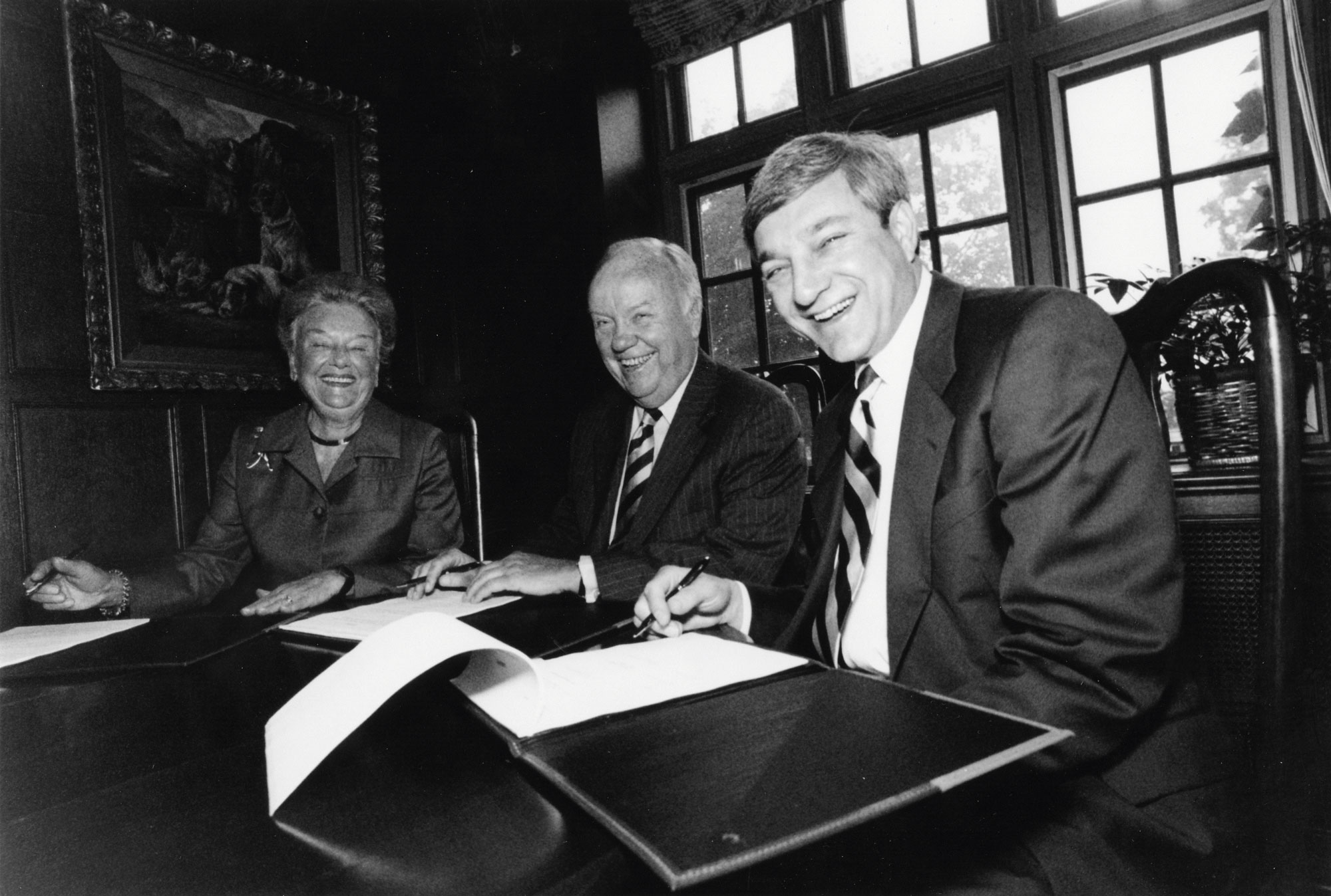 Дональд Риган (нафото в центре) превратил Merrill Lynch в «банк мечты»